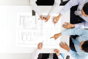 Team Reviewing Restaurant Blueprints